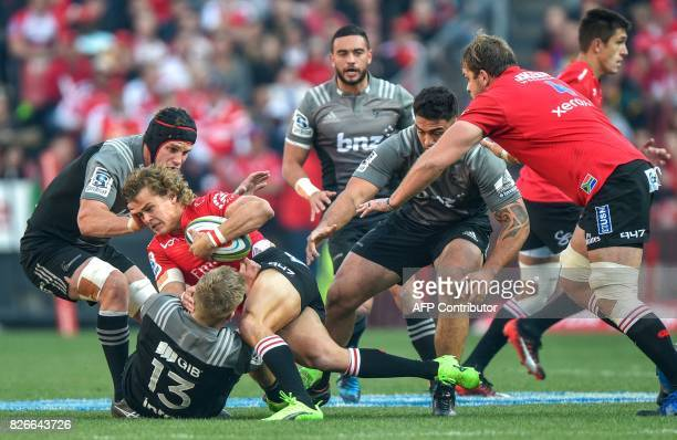 Jack Goodhue of the Crusaders tales Andries Coetzee of the Lions during the SuperXV rugby final match between the Lions and the Crusaders at Ellis...