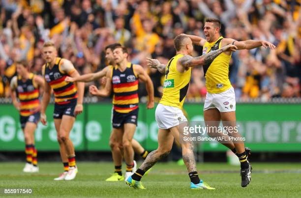 Jack Graham of the Tigers celebrates after kicking a goal with Dustin Martin of the Tigers during the 2017 AFL Grand Final match between the Adelaide...