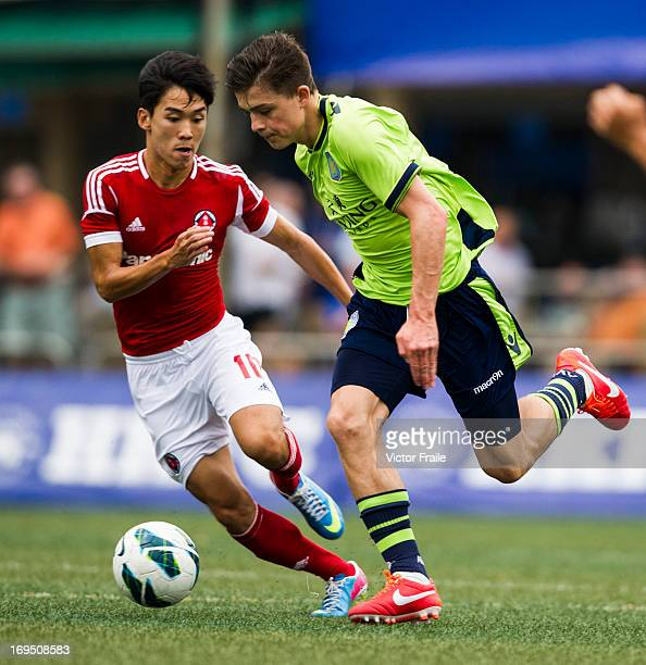 Jack Grealish of Aston Villa and Au Yeung Yiu Chung of South China fight for the ball on day three of the Hong Kong International Soccer Sevens at...