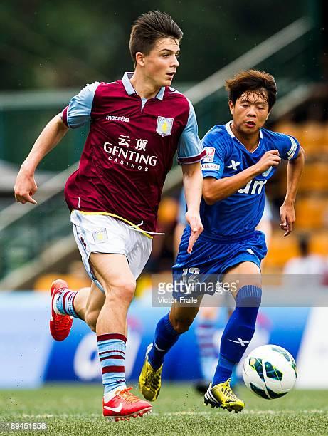 Jack Grealish of Aston Villa and Li Ka Chun of BC Rangers fight for the ball on day two of the Hong Kong International Soccer Sevens at Hong Kong...