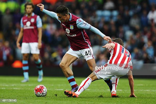 Jack Grealish of Aston Villa and Marco van Ginkel of Stoke City compete for the ball during the Barclays Premier League match between Aston Villa and...