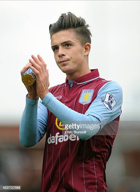 Jack Grealish of Aston Villa applauds the supporters following the Barclays Premier League match between Stoke City and Aston Villa on August 16 2014...