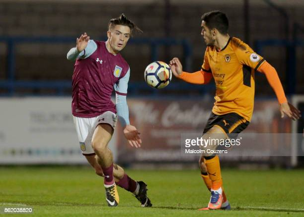 Jack Grealish of Aston Villa competes with Jose Xavier of Wolverhampton Wanderers during the Premier League 2 game between Wolverhampton Wanderers...