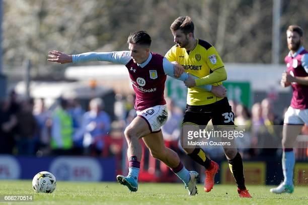 Jack Grealish of Aston Villa competes with Luke Murphy of Burton Albion during the Sky Bet Championship match between Burton Albion and Aston Villa...