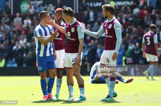 Jack Grealish of Aston Villa consoles Anthony Knockaert of Brighton and Hove Albion after the Sky Bet Championship match between Aston Villa and...