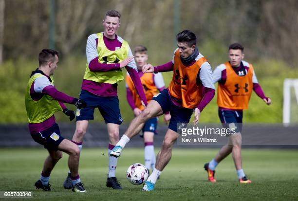 Jack Grealish of Aston Villa in action with team mate Alex Prosser during a Aston Villa training session at the club's training ground at Bodymoor...