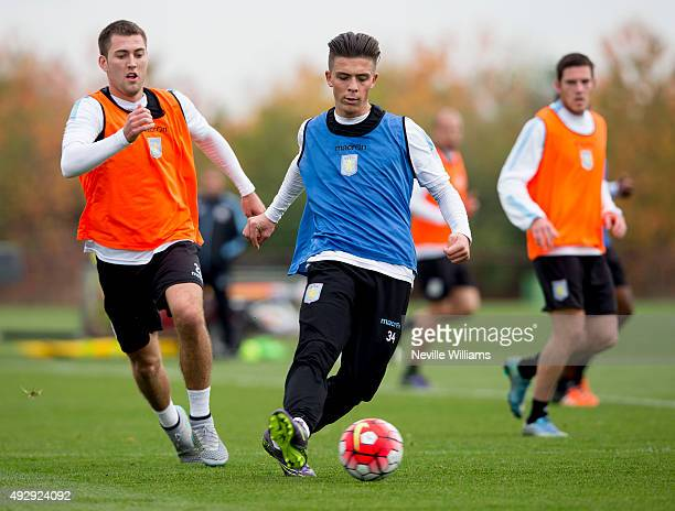 Jack Grealish of Aston Villa in action with team mate Gary Gardner during a Aston Villa training session at the club's training ground at Bodymoor...