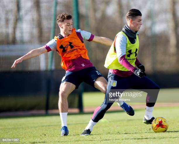 Jack Grealish of Aston Villa in action with team mate James Chester during a Aston Villa training session at the club's training ground at Bodymoor...
