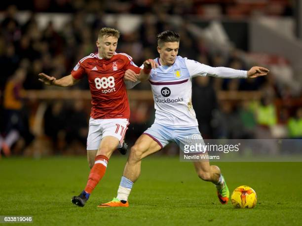 Jack Grealish of Aston Villa is challenged by Ben Osborn of Nottingham Forest during the Sky Bet Championship match between Nottingham Forest and...