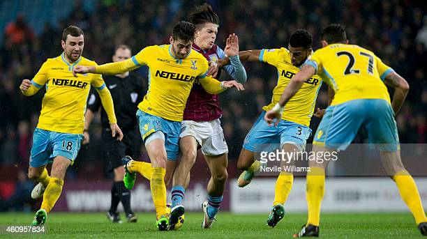Jack Grealish of Aston Villa is challenged by Joel Ward of Crystal Palace during the Barclays Premier League match between Aston Villa and Crystal...
