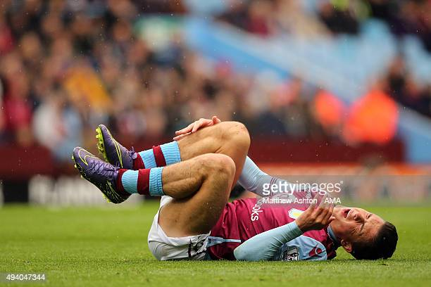 Jack Grealish of Aston Villa lies injured during the Barclays Premier League match between Aston Villa and Swansea City at Villa Park on October 24...