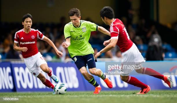 Jack Grealish of Aston Villa moves the ball against Au Yeung Yiu Chung and Michael Cheng Lai Hin of South China on day three of the Hong Kong...