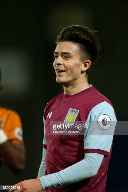 Jack Grealish of Aston Villa reacts following a caution from the referee during the Premier League 2 game between Wolverhampton Wanderers and Aston...