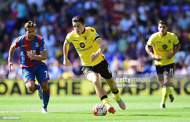 Jack Grealish of Aston Villa sprints away from Yohan Cabaye of Crystal Palace during the Barclays Premier League match between Crystal Palace and...