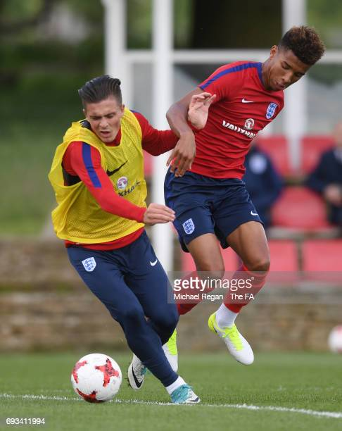 Jack Grealish of England U21 is challenged by Mason Holgate of England U21 during the England U21 training session at St Georges Park on June 7 2017...