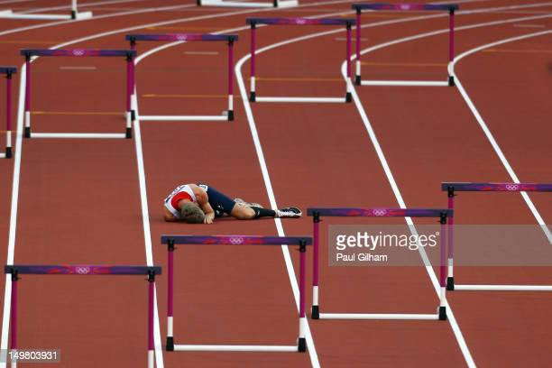 Jack Green of Great Britain lies after falling in the Men's 400m Hurdles Semi Final on Day 8 of the London 2012 Olympic Games at Olympic Stadium on...