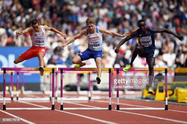 Jack Green of Great Britain Mamadou Kasse Hann of France and Patryk Dobek of Poland competes in the Men's 400 metres hurdles during day three of the...