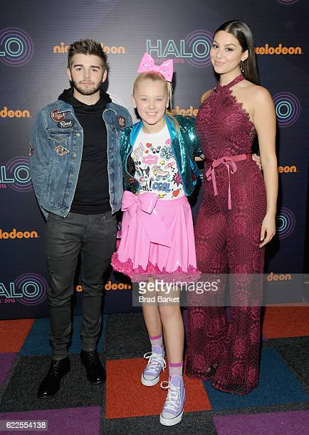 Jack Griffo JoJo Siwa and Kira Kosarin pose backstage during the 2016 Nickelodeon HALO awards at Basketball City Pier 36 South Street on November 11...