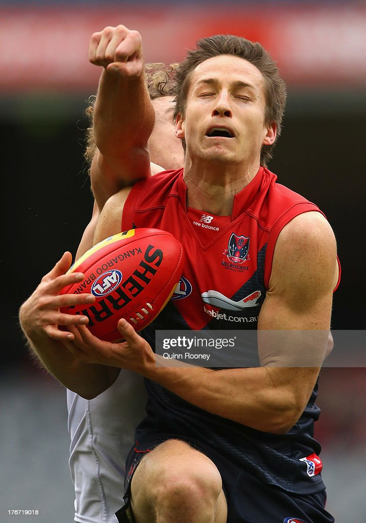 Jack Grimes of the Demons marks during the round 21 AFL match between the Melbourne Demons and the Fremantle Dockers at Melbourne Cricket Ground on August 18, 2013 in Melbourne, Australia.