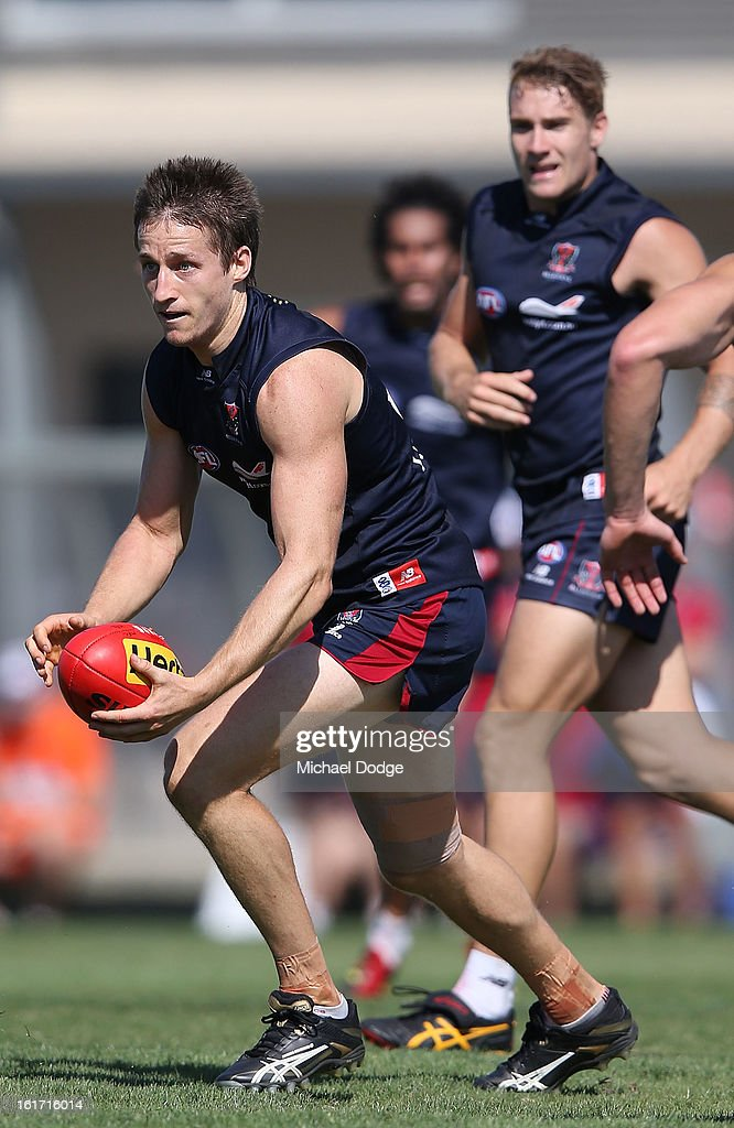 Jack Grimes runs with the ball during a Melbourne Demons intra-club match session at Casey Fields on February 15, 2013 in Melbourne, Australia.