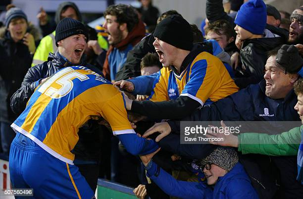 Jack Grimmer of Shrewsbury TMark Howard of Sheffield United celebrates winning with fans after the Emirates FA Cup Fourth Round match between...