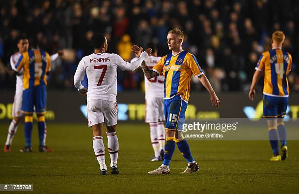 Jack Grimmer of Shrewsbury Town and Memphis Depay of Manchester United shake hands after the Emirates FA Cup fifth round match between Shrewsbury...