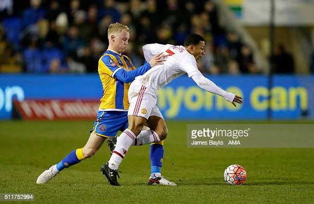 Jack Grimmer of Shrewsbury Town and Memphis Depay of Manchester United during the Emirates FA Cup match between Shrewsbury Town and Manchester United...