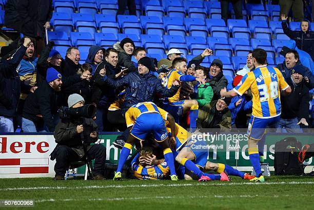Jack Grimmer of Shrewsbury Town is mobbed by fans and his team mates after he scores to make it 32 during the Emirates FA Cup match between...