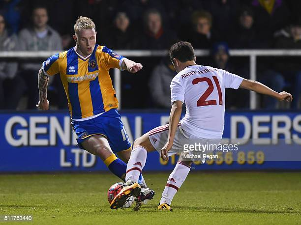 Jack Grimmer of Shrewsbury Town takes on Ander Herrera of Manchester United during the Emirates FA Cup fifth round match between Shrewsbury Town and...