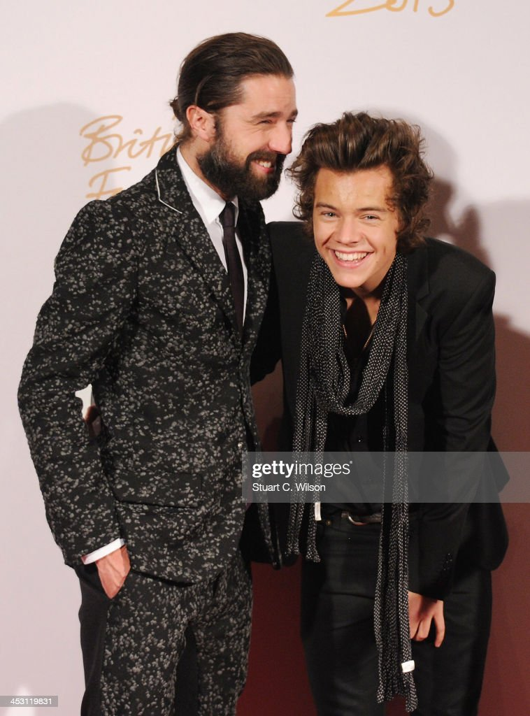Jack Guinness (L) and <a gi-track='captionPersonalityLinkClicked' href=/galleries/search?phrase=Harry+Styles&family=editorial&specificpeople=7229830 ng-click='$event.stopPropagation()'>Harry Styles</a> with the British Style bought to you by Vodaphone Award and Alexa Chung poses in the winners room at the British Fashion Awards 2013 at London Coliseum on December 2, 2013 in London, England.