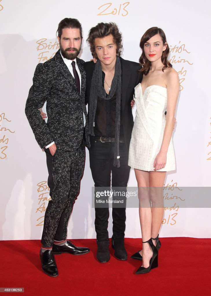 Jack Guinness, Harry Styles and Alexa Chung poses in the winners room at the British Fashion Awards 2013 at London Coliseum on December 2, 2013 in London, England.