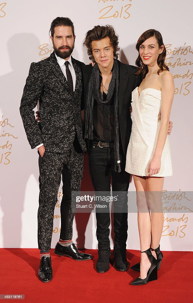 Jack Guinness, Harry Styles with the British Style bought to you by Vodaphone Award and Alexa Chung poses in the winners room at the British Fashion Awards 2013 at London Coliseum on December 2, 2013 in London, England.