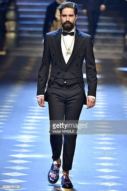 Jack Guinness walks the runway at the Dolce Gabbana show during Milan Men's Fashion Week Fall/Winter 2017/18 on January 14 2017 in Milan Italy