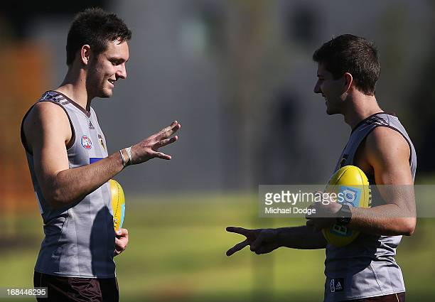 Jack Gunston and Luke Breust play the paperrockscissors game during a Hawthorn Hawks AFL training session at Waverley Park on May 10 2013 in...