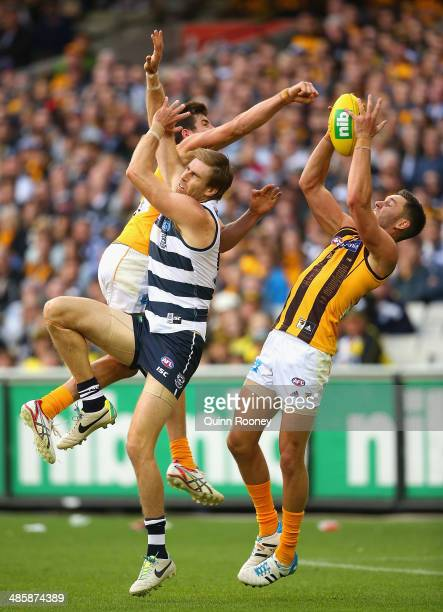 Jack Gunston of the Hawks marks infront of Tom Lonergan of the Cats during the round five AFL match between the Geelong Cats and the Hawthorn Hawks...