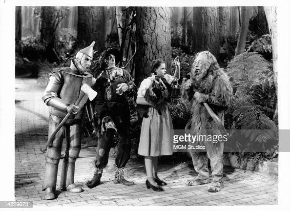 Jack Haley as the Tin Man Ray Bolger as the Scarecrow Judy Garland as Dorothy Gale and Bert Lahr as the Cowardly Lion in a scene from the film 'The...