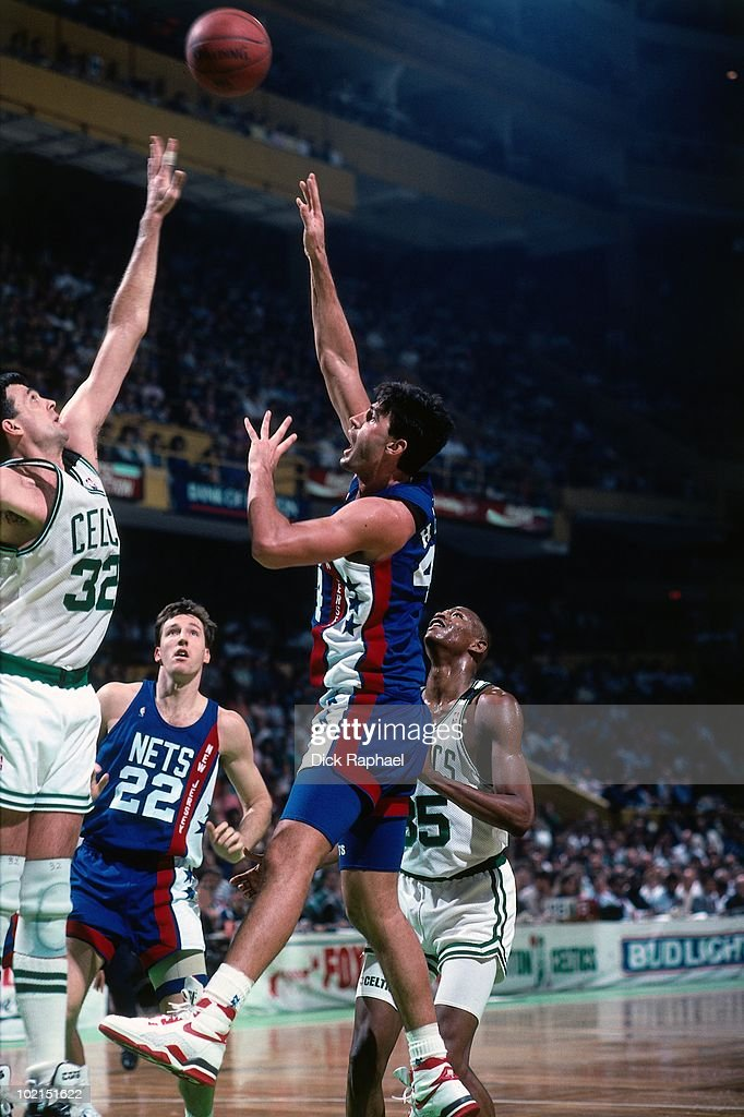 Jack Haley #44 of the New Jersey Nets shoots against Kevin McHale #32 of the Boston Celtics during a game played in 1990 at the Boston Garden in Boston, Massachusetts.