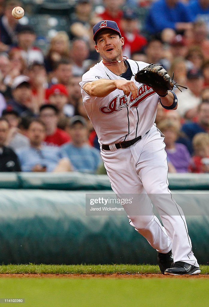 <a gi-track='captionPersonalityLinkClicked' href=/galleries/search?phrase=Jack+Hannahan&family=editorial&specificpeople=579381 ng-click='$event.stopPropagation()'>Jack Hannahan</a> #9 of the Cleveland Indians throws to first base against the Tampa Bay Rays during the game on May 11, 2011 at Progressive Field in Cleveland, Ohio.
