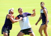Jack Hannath and Aaron Sandilands contest for the ball as Scott Gumbleton looks on during a Fremantle Dockers AFL preseason training session at...