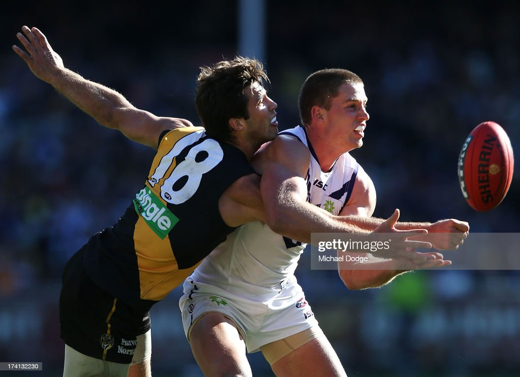 Jack Hannath of the Dockers and Alex Rance (L) of the Tigers contest for the ball during the round 17 AFL match between the Richmond Tigers and the Fremantle Dockers at Melbourne Cricket Ground on July 21, 2013 in Melbourne, Australia.