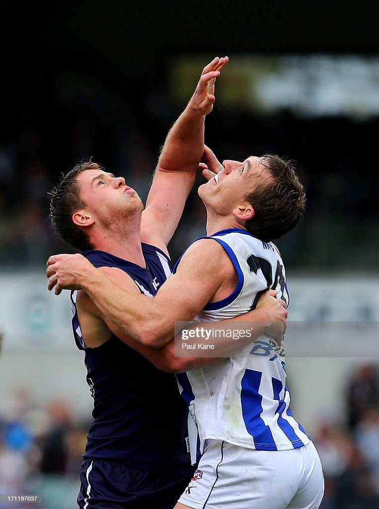Jack Hannath of the Dockers and <a gi-track='captionPersonalityLinkClicked' href=/galleries/search?phrase=Drew+Petrie&family=editorial&specificpeople=216448 ng-click='$event.stopPropagation()'>Drew Petrie</a> of the Kangaroos contest the ruck during the round 13 AFL match between the Fremantle Dockers and the North Melbourne Kangaroos at Patersons Stadium on June 23, 2013 in Perth, Australia.