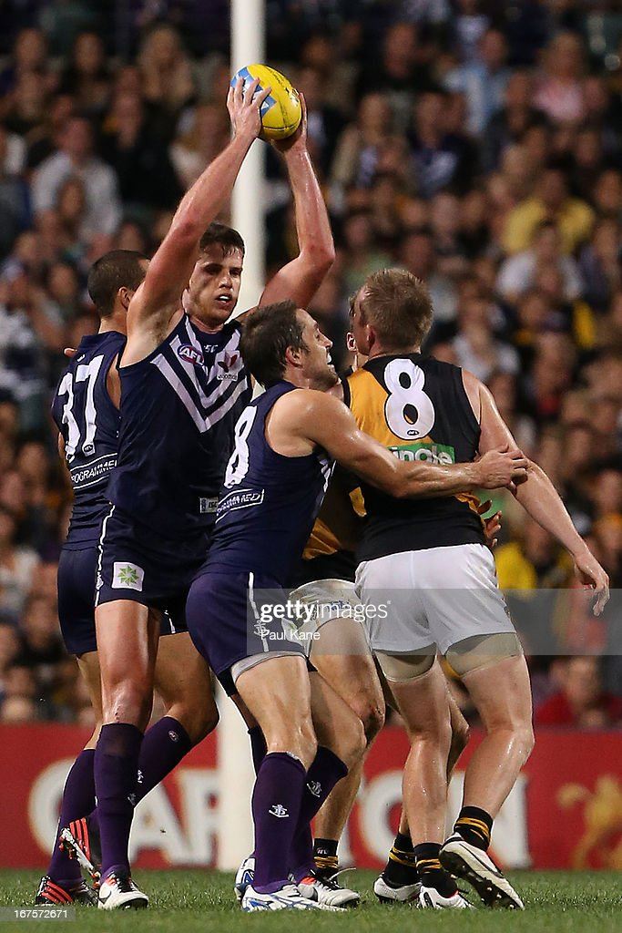 Jack Hannath of the Dockers marks the ball in the dying stages of the game during the round five AFL match between the Fremantle Dockers and the Richmond Tigers at Patersons Stadium on April 26, 2013 in Perth, Australia.