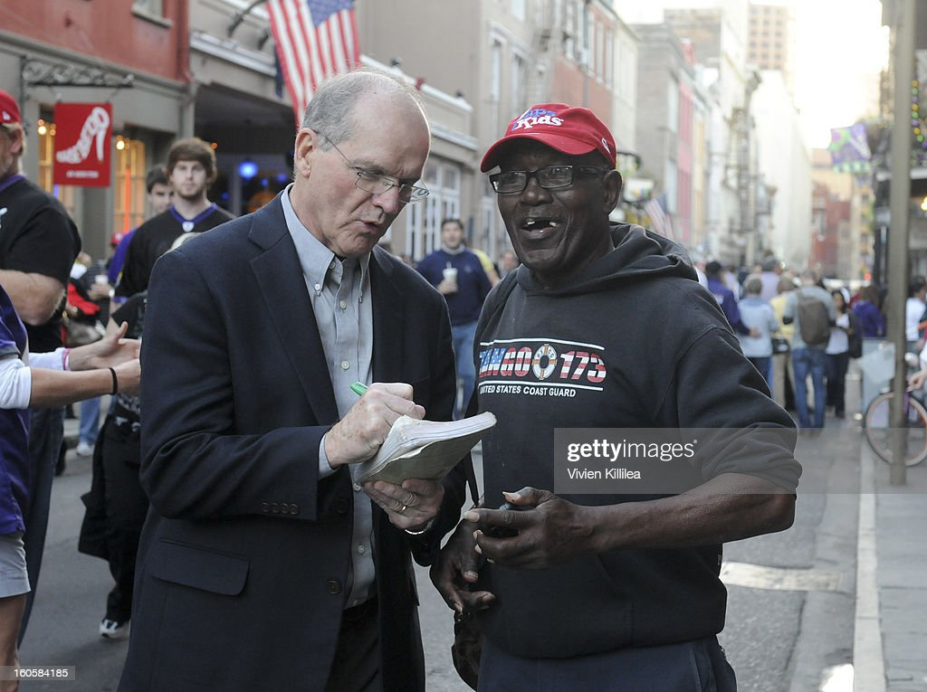 Jack Harbaugh signs an autograph for a fan at Starter Parlor - Super Bowl XLVII on February 2, 2013 in New Orleans, Louisiana.