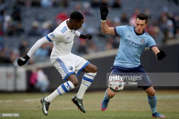 Jack Harrison of New York City FC challenged by Ambroise Oyongo of Montreal Impact during the New York City FC Vs Montreal Impact regular season MLS...
