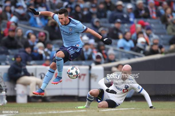 Jack Harrison of New York City FC challenged by Laurent Ciman of Montreal Impact during the New York City FC Vs Montreal Impact regular season MLS...