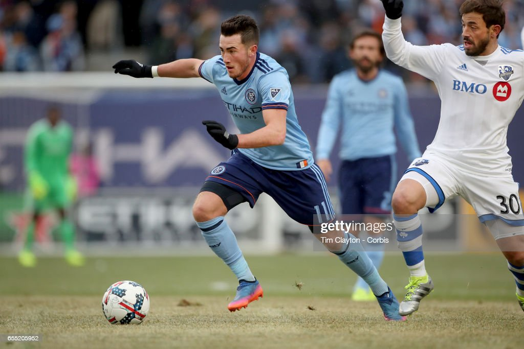 Jack Harrison #11 of New York City FC goes past Hernan Bernardello #30 of Montreal Impact in action during the New York City FC Vs Montreal Impact regular season MLS game at Yankee Stadium on March 18, 2017 in New York City.