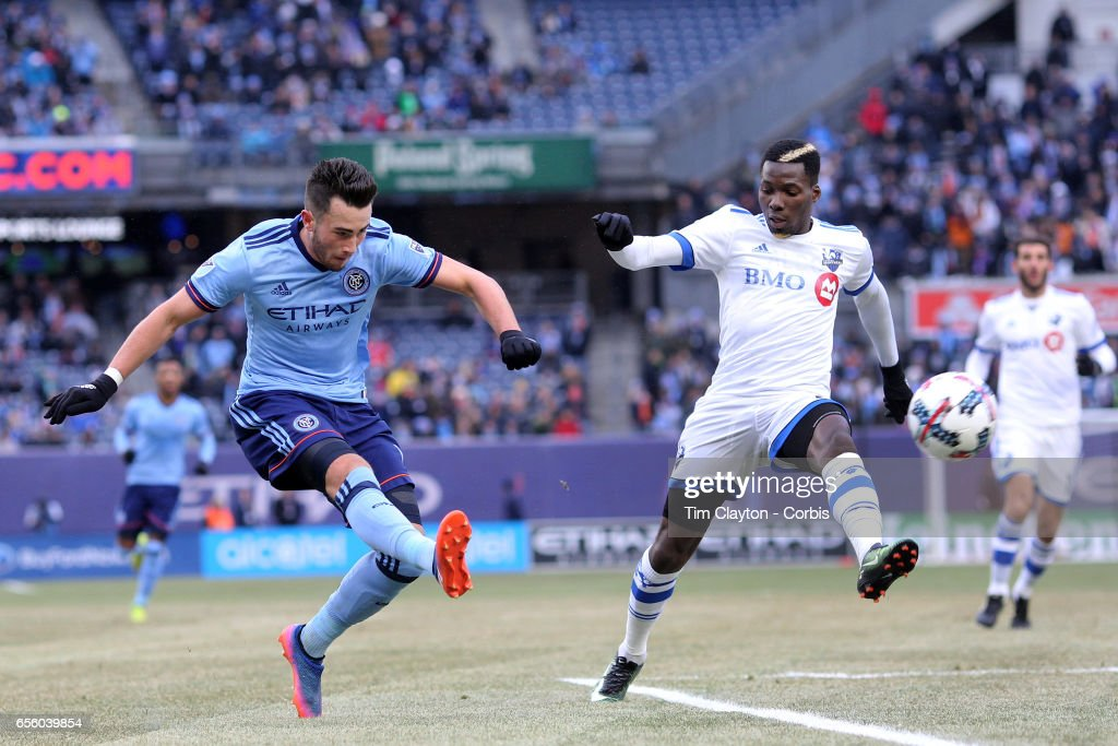 Jack Harrison #11 of New York City FC shoots past Ambroise Oyongo #2 of Montreal Impact during the New York City FC Vs Montreal Impact regular season MLS game at Yankee Stadium on March 18, 2017 in New York City.