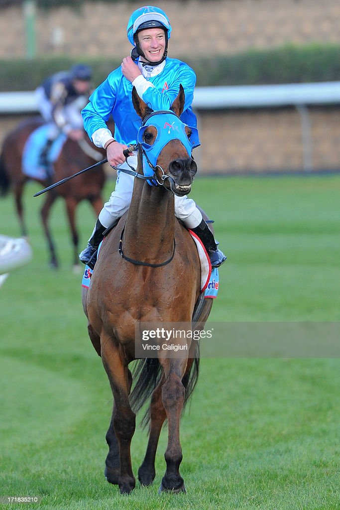 Jack Hill riding De Fine Lago after winning the Dominant Handicap during Melbourne Racing at Moonee Valley Racecourse on June 29, 2013 in Melbourne, Australia.