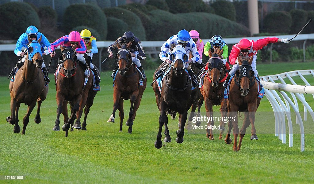 Jack Hill riding De Fine Lago (far left) turns into home straight and win the Dominant Handicap during Melbourne Racing at Moonee Valley Racecourse on June 29, 2013 in Melbourne, Australia.
