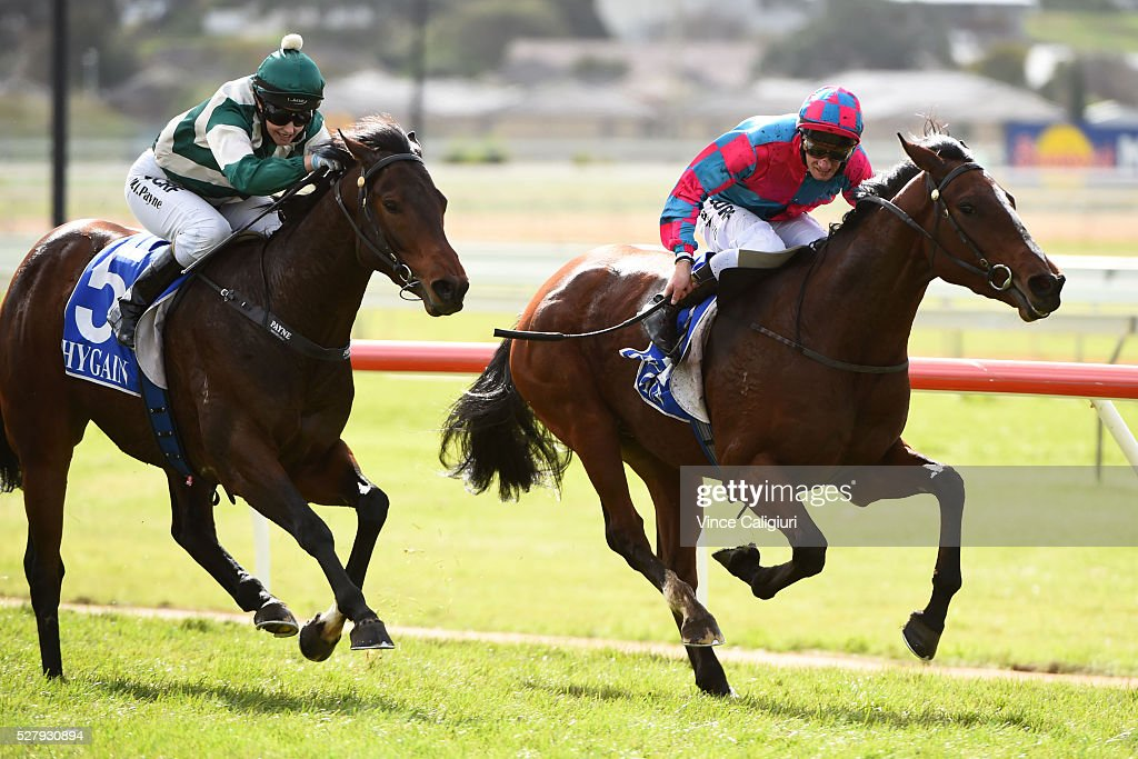 Jack Hill riding Vatiaz defeats <a gi-track='captionPersonalityLinkClicked' href=/galleries/search?phrase=Michelle+Payne&family=editorial&specificpeople=2296250 ng-click='$event.stopPropagation()'>Michelle Payne</a> riding Sadia in Race 3 during Brierly Day at Warrnambool Race Club on May 4, 2016 in Warrnambool, Australia.